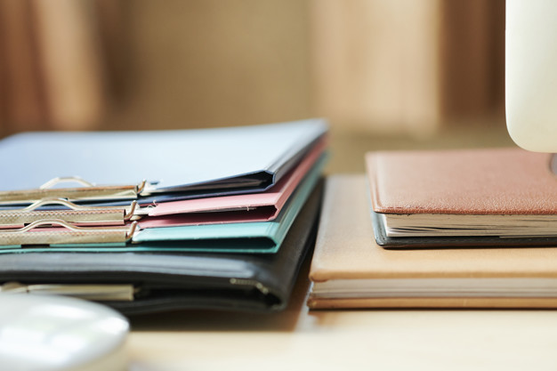 Folders and planners on office desk